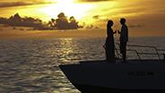 Couple on romantic sunset boat ride